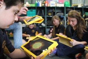 Our Grade 5 students using the iPads to learn about our solar system